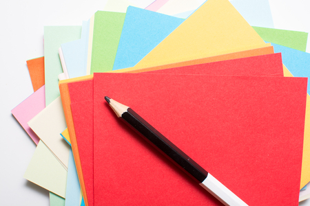 Sheets of bright colored art paper and pencil for drawing Stockfoto