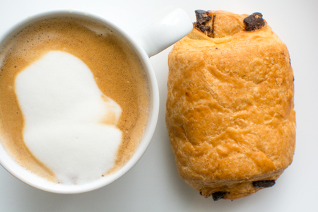 breakfast food on a plate, cappuccino coffee and chocolate croissant Stock Photo
