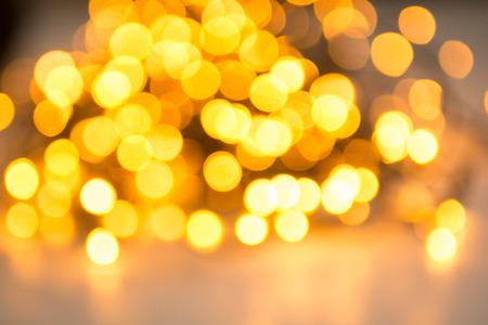 Christmas lights abstract with shiny yellow bokeh effect