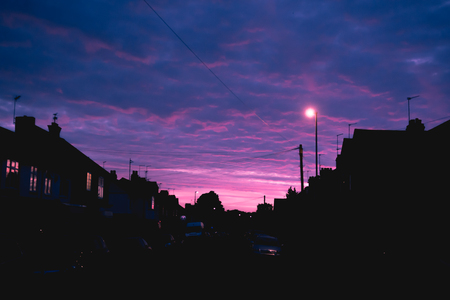 Night time view of house exterior of terraced houses on a street Stock Photo