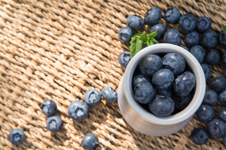 Blueberries. Freshly picked blueberry in ceramic bowl with berries and natural background. Blueberries are known to contain anitoxidant for nutrition health benefits