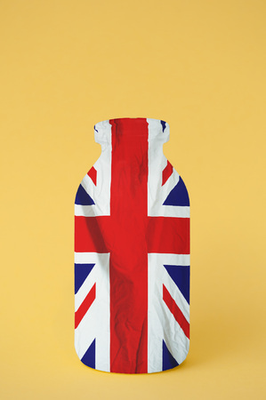 Made in Britain concept of milk bottle with Union Jack flag