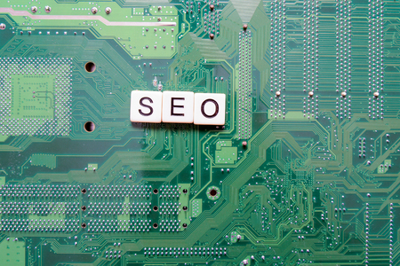 Search Engine Optimization concept with letters SEO spelled out on computer
