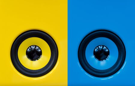 Bright blue and yellow speakers for playing loud dance party music, modern abstract objects
