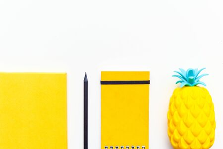 Top view image of office supplies or school accessories, trendy yellow colour objects shot from overhead