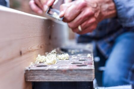Close up of male hands doing woodwork using tools Banque d'images