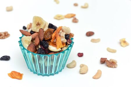 Healthy snack food trail mix of mixed nuts and dried fruits
