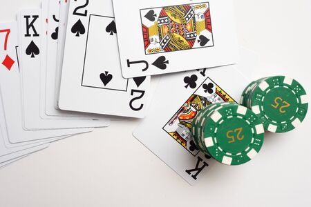 Black Jack cards with pile of casino chips as winning bet