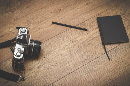 Retro style objects for blogging photography and writing on vintage wooden background Stock fotó