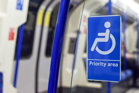 Priority seating area for people using wheelchair or with a disability on public transport train Stock Photo