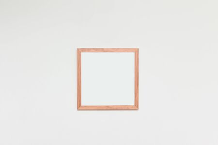 Empty picture frame with blank space for photo or art on a white interior wall Фото со стока
