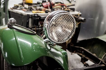 Classic car being restored to original condition in workshop