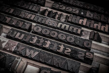 wooden letters blocks from old letterpress alphabet used for typesetting Фото со стока