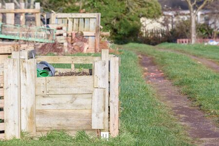 Compost heap at a community garden to make fertile soil to grow vegetables
