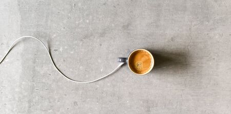 Concept for charging mobile device by sharing charge from caffinated drink