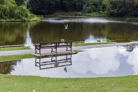 Flood water overflows from a lake during flooding after heavy rain and bad weather