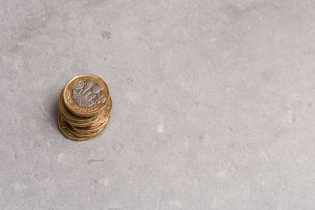 New pound coins from english sterling currency in a pile