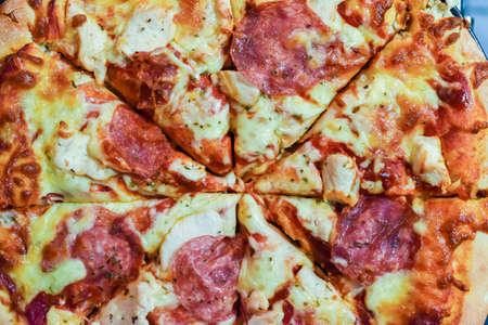 Fresh home made pizza with meats and cheese