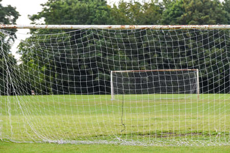Outdoor football pitch with goals and soccer nets in public park