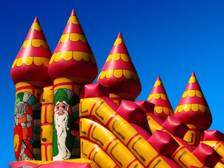 Childrens bouncy castle detail, against a summers clear deep blue sky