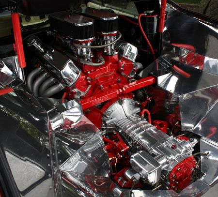 engine compartment: A well-polished red and silver engine in its engine bay