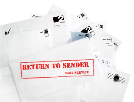Return to sender, with copyspace. A pile of mail, possibly junk mail, or the recipient has gone away. The most prominent envelope is marked return to sender