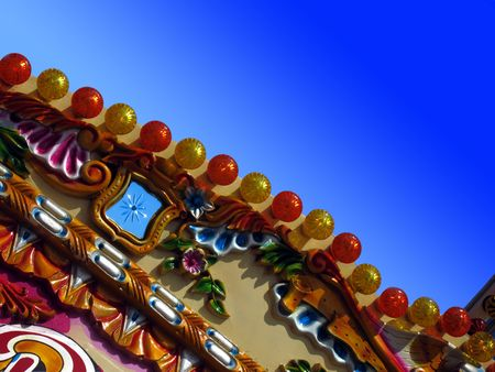 evocative: Detail from a beachside merry-go-round against a clear blue summer sky. Ideal for evocative summer memory concepts.