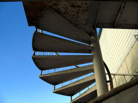 slightly: Spiral staircase slightly silhouetted against a blue summer sky