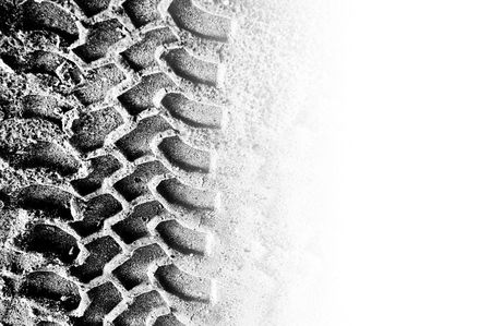 tyre tread: Tyre tread pattern in sand with area of copyspace