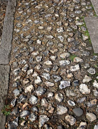 flint: old fashioned pathway made up of flint stones Stock Photo