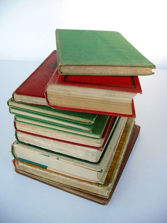 antiquarian: A pile of antiquarian hardcover book. Mainly red and green in colour