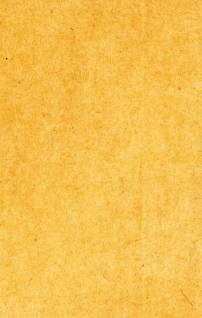 Old brown antique paper background. Ideal for nostalgia based scrapbooking projects photo