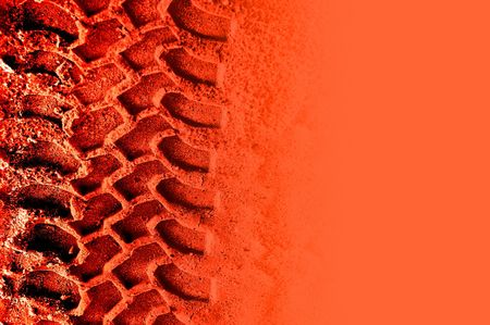 Tyre tracks on red with copyspace. Useful for concepts regarding the life on mars debate