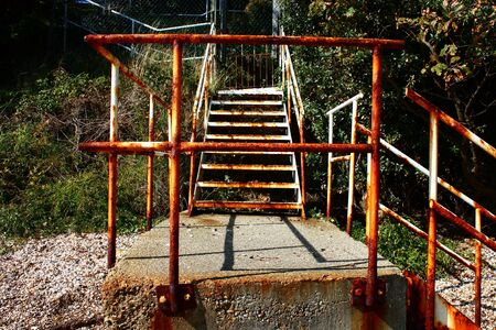 banisters: Rusting metal staircase and banisters