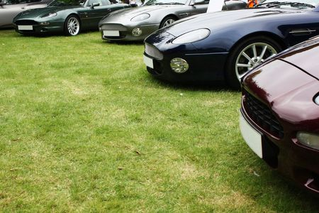 A crescent of luxury cars, with an area of copyspace Stock Photo