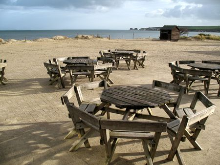 View of seashore with tables and eating area photo
