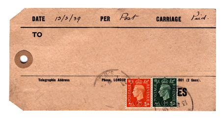 postmarked: Genuine 1930s parcel tag with cancelled stamps