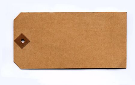 plain: Genuine vintage parcel tag from the 1930s against a lightly textured paper background