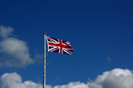 Union Flag on a windy day. This is the flag, generally regarded, to represent the peoples of England, Scotland, Wales and Northern Ireland. The image may show the effect of the wind at full size. Stock Photo - 4888650