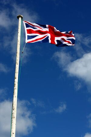 Union Flag amd pole on a windy day. This is the flag, generally regarded, to represent the peoples of England, Scotland, Wales and Northern Ireland. The image may show the effect of the wind at full size. photo