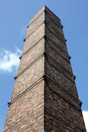 industrial heritage: Single old fashioned brick victorian chimney stack Stock Photo