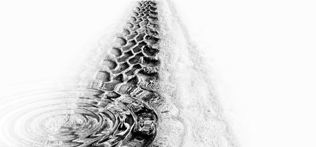 Tyre track and puddle ripples