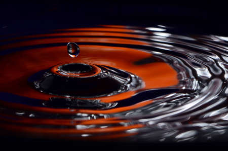 Orange And Silver Water With Drop Stock Photo