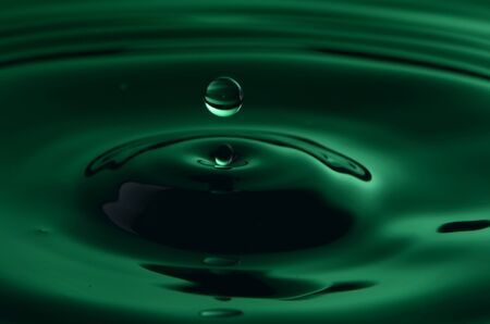 Green Water With Falling Drop
