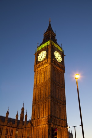 Big Ben London in the evening with dark blue sky photo