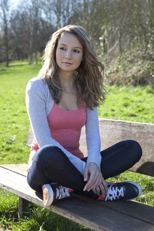 Young woman relaxing in park on  a sunny day photo
