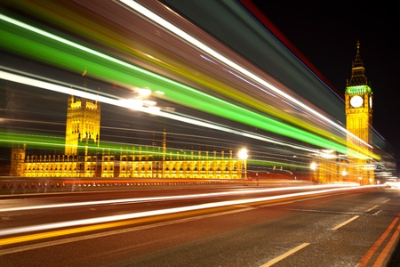 incoming: Big Ben and Houses of Parliament in London with lights effect from incoming bus