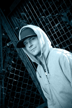 Young man with a blue hat and a hoodie photo