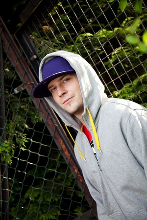Young man with a blue hat and a hoodie Stock Photo - 9700404