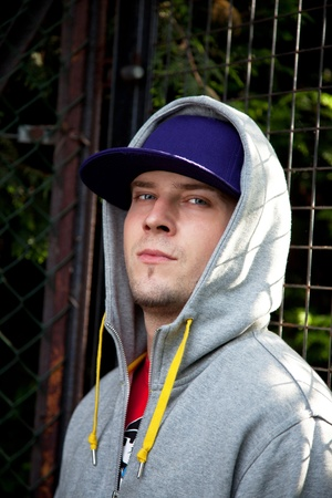 hoodie: Young man  wearing a hat with hoodie